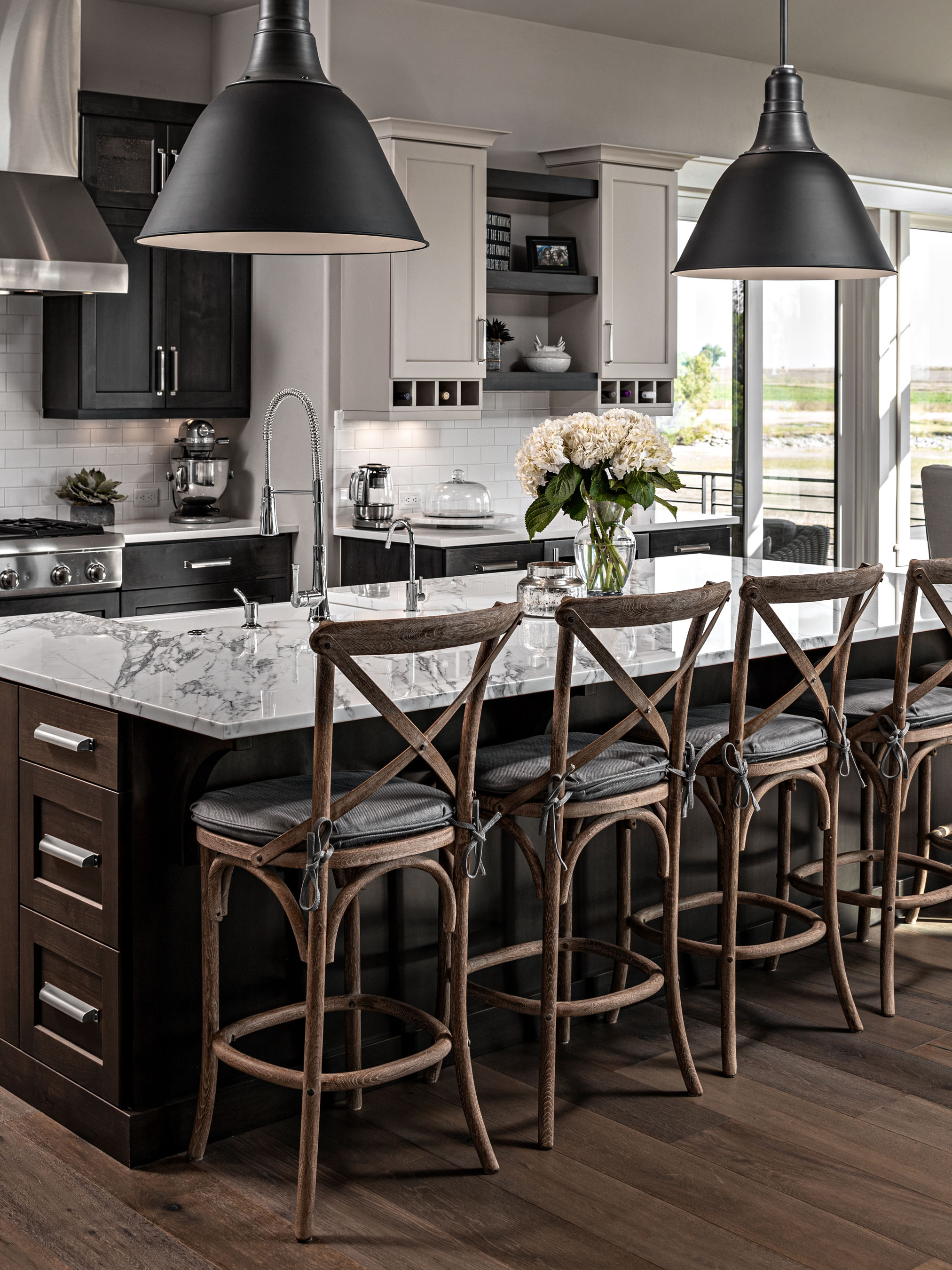 Interior photography of kitchen with big pendants–Timnath, Colorado residence located in WildWing.