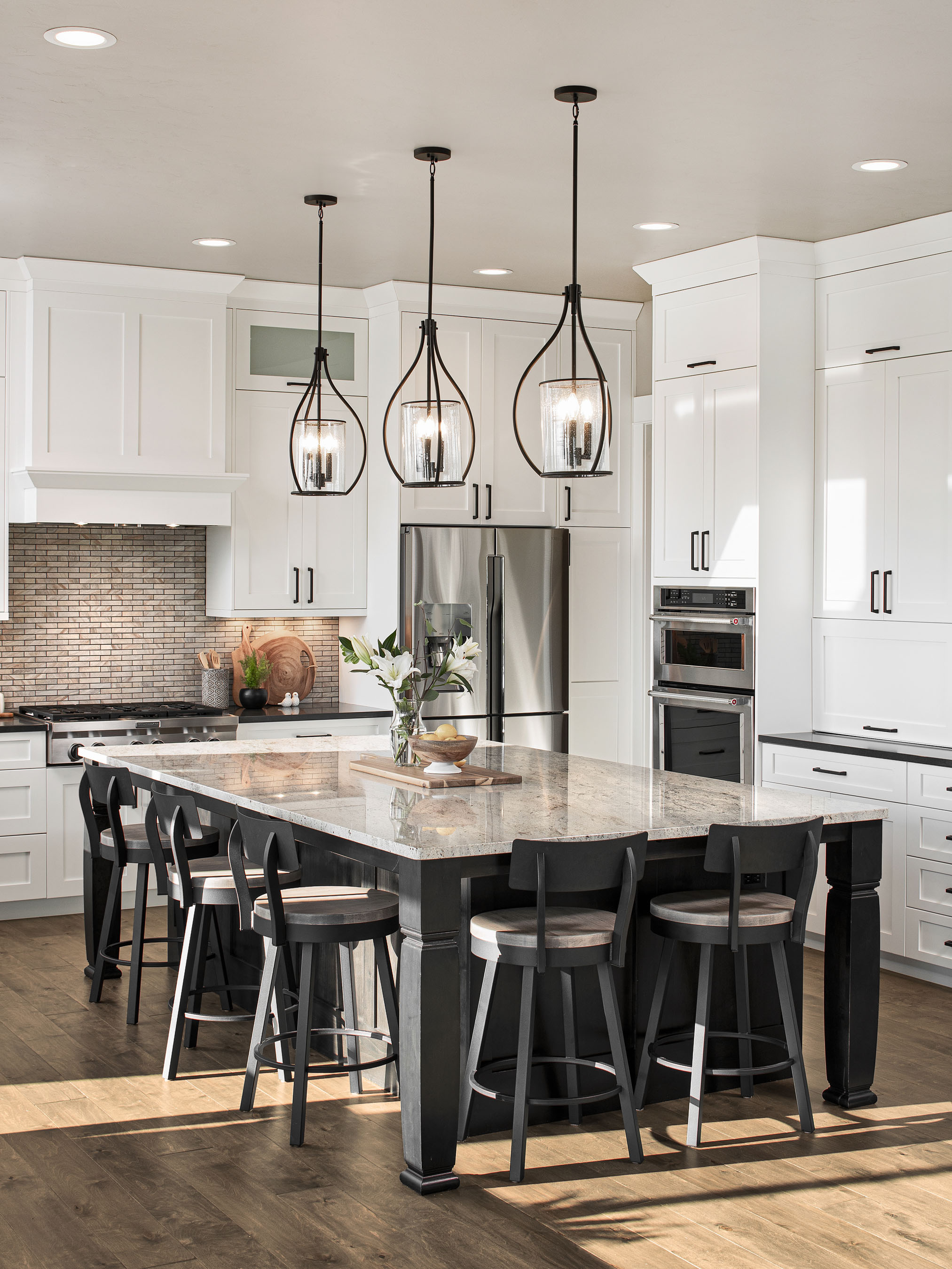 Interior photography of kitchen with white cabinets–Timnath, Colorado residence located in WildWing.