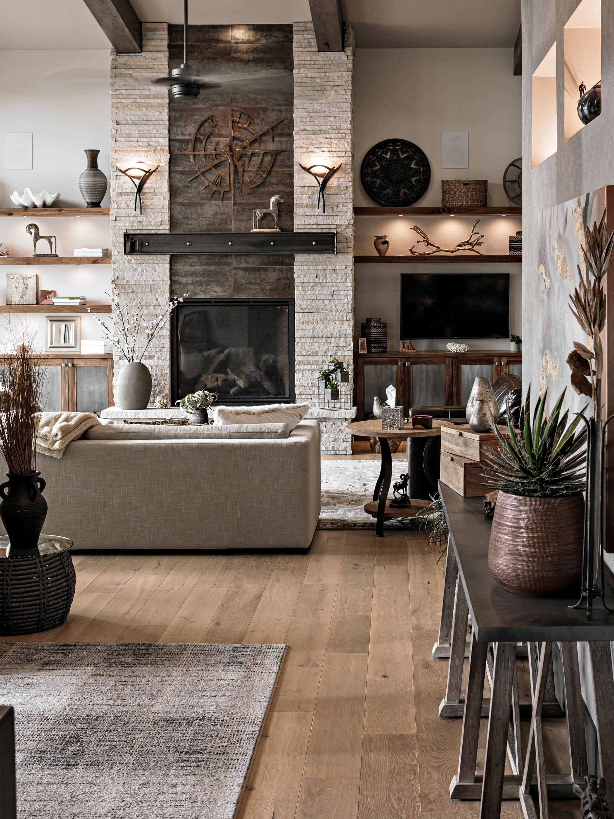 Interior photography of living room with stone fireplace–Loveland, Colorado residence located in Hidden Valley Estates.
